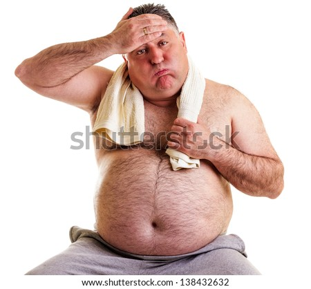 Overweight man resting, tired after training, with hand on forehead against white
