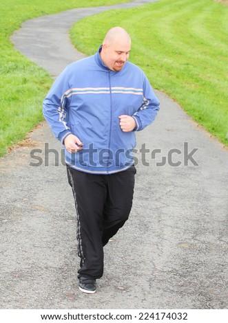 Overweight man running. Weight loss concept. - stock photo