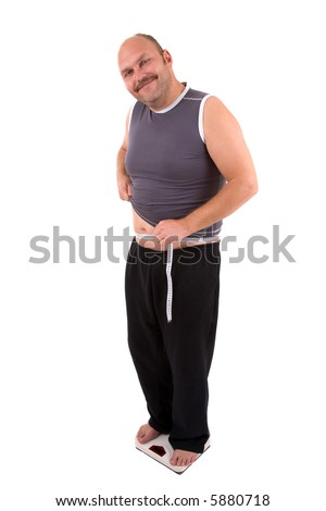 Overweight man standing on a weighing scale looking very smug - stock photo