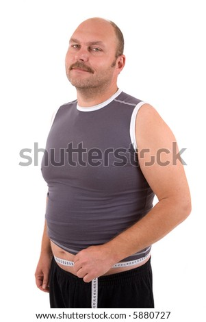 Overweight man standing with a measuring tape around his beer belly and looking pleased with himself