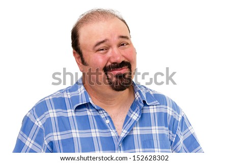 Overweight man with a goatee beard and a skeptical expression looking at the camera with his eyebrows raised in distrust and a cynical smile, isolated on white - stock photo