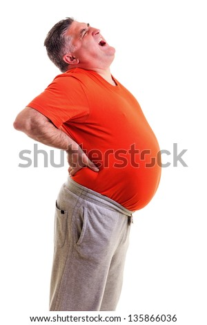 Overweight man with acute back ache bending over backwards to attenuate the pain, with agonized expression on his face, against white