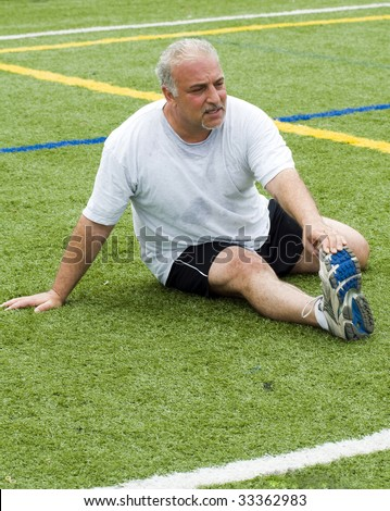 overweight middle age senior man stretching his muscles fitness healthy lifestyle image - stock photo