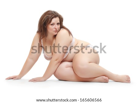 Overweight woman dressed in underwear isolated on a white background.  - stock photo