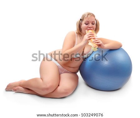 Overweight woman eating big sandwich with ham. - stock photo