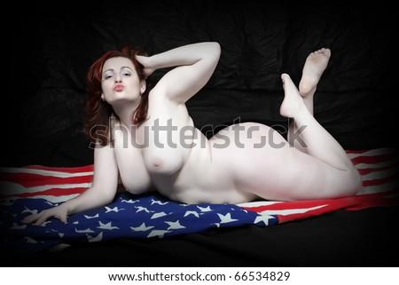 Overweight woman posing on american flag. Conceptual image - unhealthy lifestyle metaphor. - stock photo