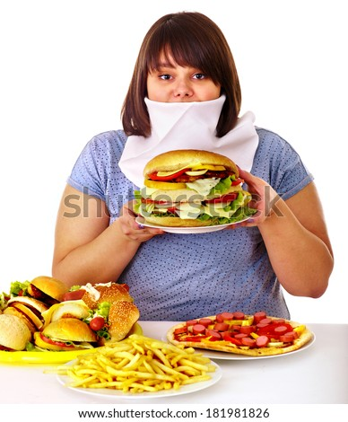 Overweight woman refusing fast food. - stock photo