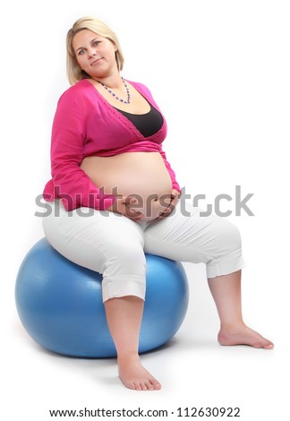Overweight woman siting on a blue ball. - stock photo