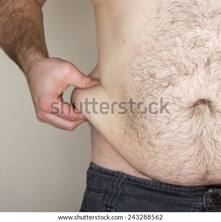 Overweigt man pinching his belly fat - stock photo