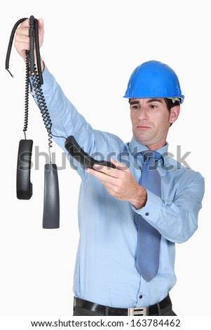 Overworked architect starting to crack - stock photo