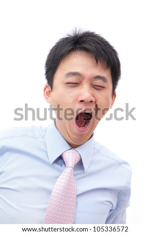overworked business man yawn with black rim of eye isolated on white background, model is a asian people - stock photo