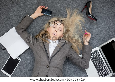 Overworked business woman - stock photo