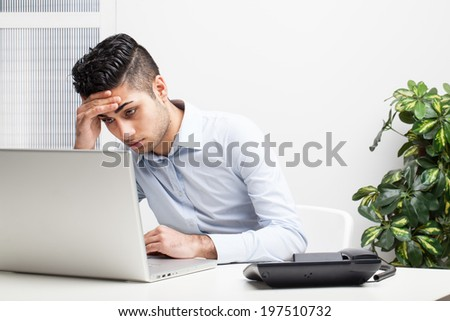 overworked businessman - stock photo