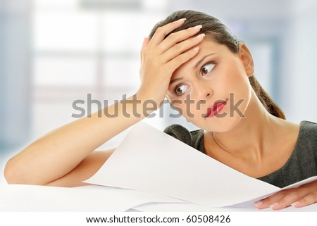 Overworked businesswoman - stock photo