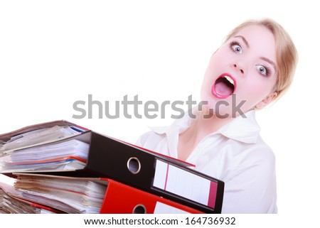 Overworked busy businesswoman secretary with stack of folders documents screaming isolated on white. Business and paperwork concept. Studio shot. - stock photo