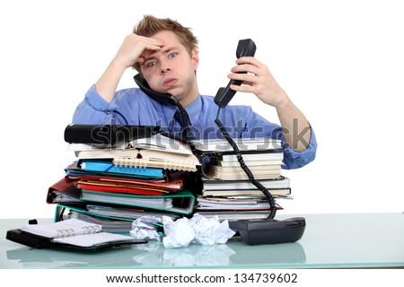 Overworked civil servant - stock photo