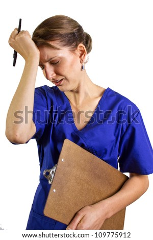 Overworked Doctor/Nurse - stock photo