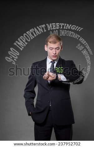 Overworked man being late on important meeting - stock photo