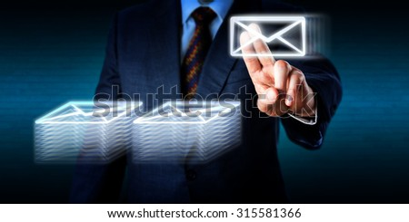 Overworked office worker is stacking many email documents in cyberspace. Business metaphor for work overload, doing overtime, archival work in the digital age and global communications technology. - stock photo