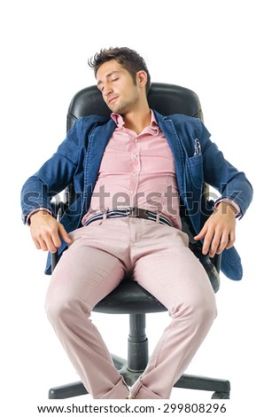 Overworked, tired young businessman sleeping on office chair, isolated on white background - stock photo