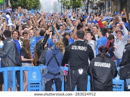 OVIEDO, SPAIN - MAY 31: Fans of Real Oviedo celebrate the rise to Liga Adelante of Spanish Football League after winning 0-1 against Cadiz CF in May 31, 2015 in Oviedo, Spain.