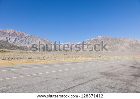 Owens Valley is the arid valley of the Owens River in eastern California in the United States, to the east of the Sierra Nevada and west of the White Mountains and Inyo Mountains - stock photo