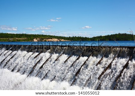 Owerflow of water cascade on the man-made storage pond. Reserves of water - stock photo