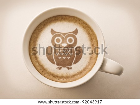 owl drawing latte art on coffee cup - stock photo