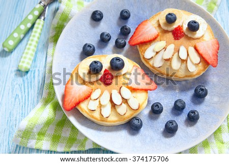 Owl pancakes for kids breakfast - stock photo