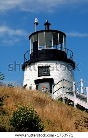 Owl's Head Light sits atop a hill overlooking the entrance to West Penobscot Bay and Rockland Harbor, Maine. - stock photo