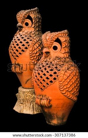 owl sculpture pottery on black background - stock photo