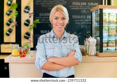 Owner of small restaurant writes order on paper - stock photo