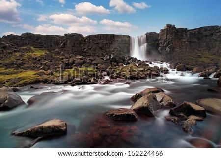 Oxararfoss waterfall in Thingvellir, Iceland - stock photo