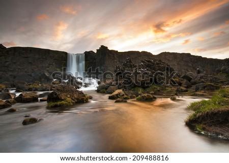 Oxararfoss waterfall in Thingvellir, Iceland. / Oxararfoss waterfall - stock photo