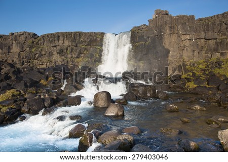 Oxararfoss waterfall in Thingvellir national park in Iceland - stock photo