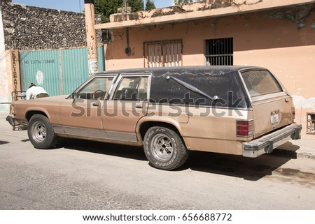 OXCUTZCAB, MEXICO - JANUARY 28,2017: Vintage hearse in Oxcutzcab Mexico January 28 2017