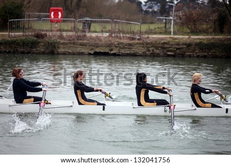 OXFORD - MAR 8: Oxford university students rowing during Torpids races on March 8, 2013 in Oxford, England. Torpids are one of annually three races with more than 1,200 participants. - stock photo