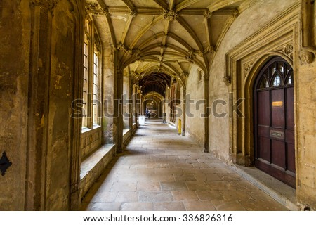 OXFORD, UK - JULY 20, 2015: Old corridors of Christ Church, University of Oxford, England. It is part of the original Priory of St Frideswide which stood before the college was built. - stock photo