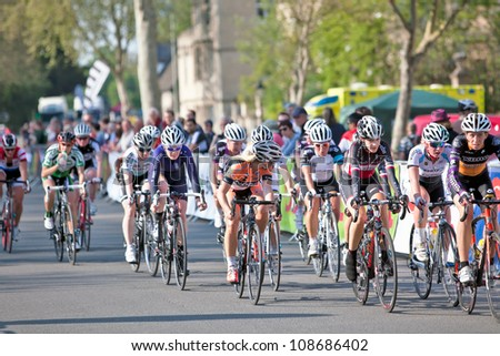 OXFORD, UK - MAY 22: Women participating in the Halfords UK Cycling Championship lead the peloton charge to catch the leading riders on the penultimate lap of the circuit on May 22, 2012 in Oxford, UK