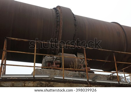 oxidation rust rotary kiln equipment, closeup of photo - stock photo