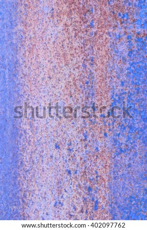 oxidized material - close up of a textured oxidized surface background design - blue and violet - stock photo