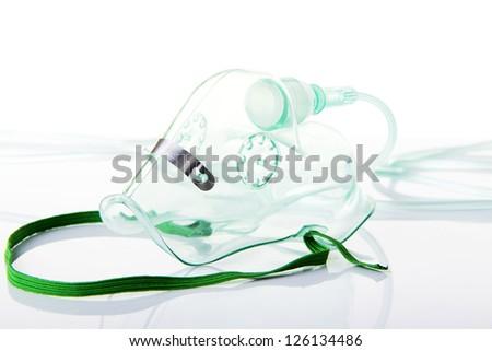 Oxygen mask on white - stock photo