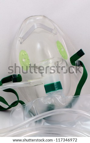 Oxygen Mask with bag in closed-up shot. - stock photo