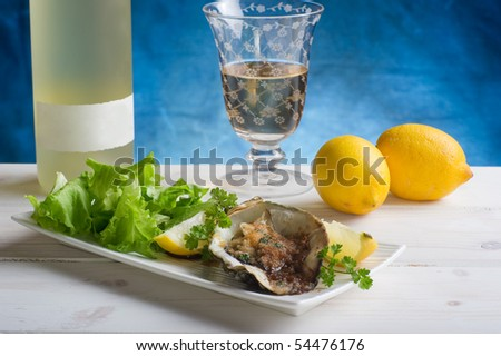 oyster au gratin with salad on dish - stock photo