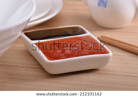 Oyster sauce and ketchup at the dinner table - stock photo