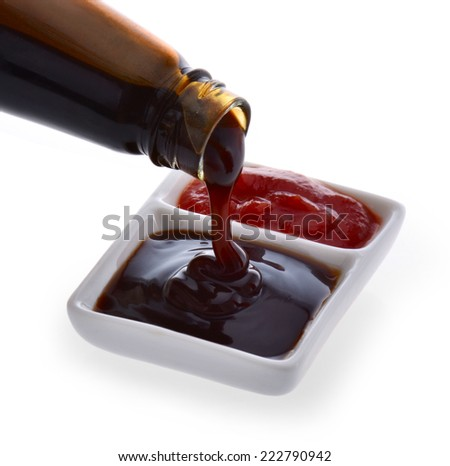 Oyster sauce poured from a bottle - stock photo
