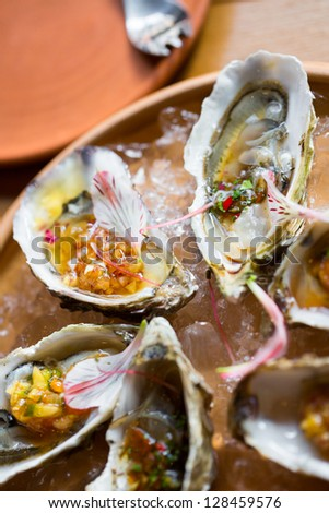 oysters with Asian sauces in ice on the plateau