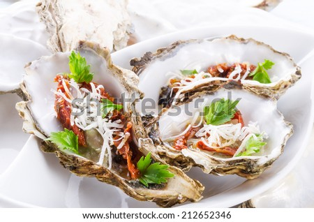 oysters with parmesan and baked tomatoes - stock photo