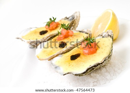 oysters with sauce and lemon - stock photo
