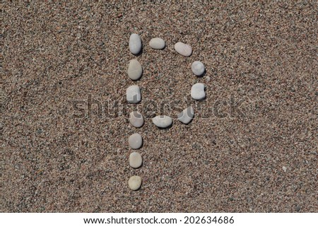 P letter made of stones on sand  - stock photo